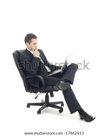 Young businessman sitting with notebook