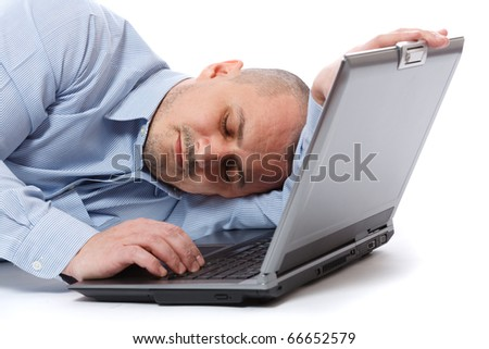 Young businessman sleeping on his laptop, isolated on white background - stock photo