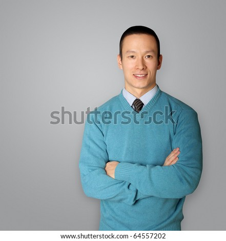 young businessman smiles on camera - stock photo