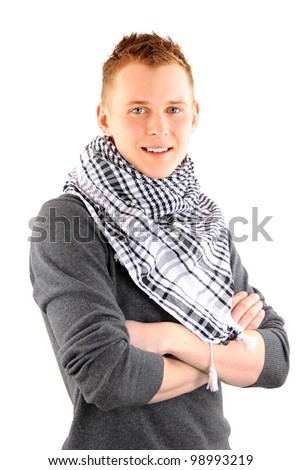 Young businessman smiles towards the camera while his colleagues meet in the background - stock photo