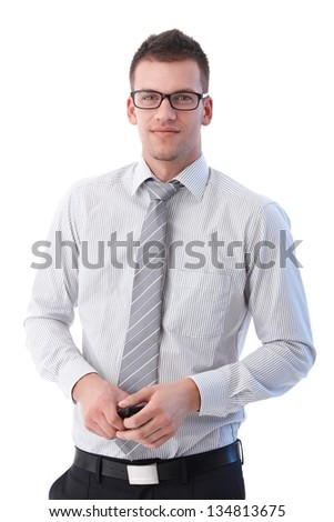 Young businessman smiling at camera, - stock photo
