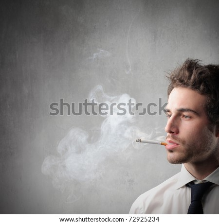 Young businessman smoking - stock photo