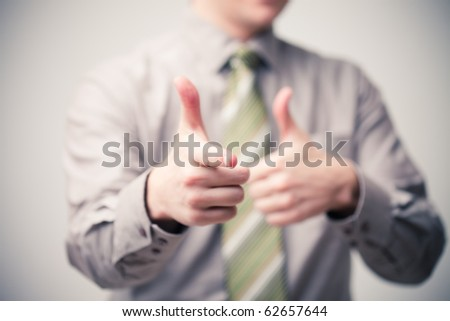 young businessman specifies in you a finger, small depth of sharpness