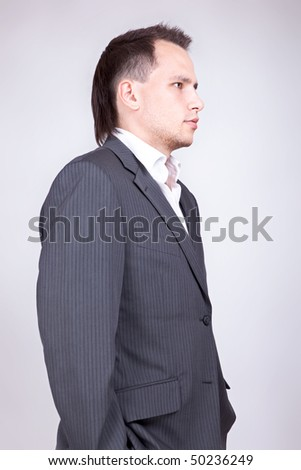 Young businessman standing.