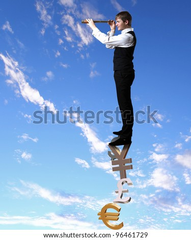 Young businessman standing and looking forward into the future - stock photo