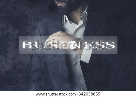 Young businessman standing hand on face. - stock photo