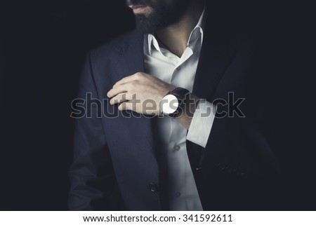 Young businessman standing the studio - stock photo