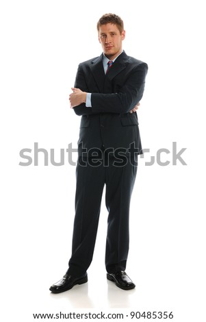 Young Businessman standing with crossed arms isolated on a white background - stock photo