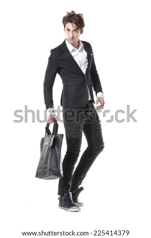 young businessman standing with his bag isolated on white background - stock photo