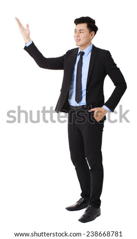 young businessman standing with showing gesture - stock photo