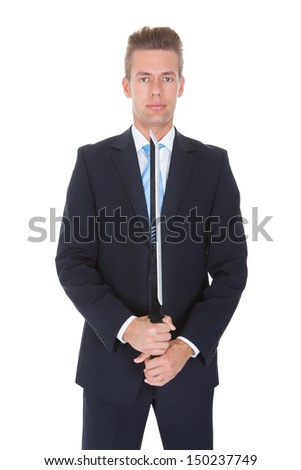 Young Businessman Standing With Sword Over White Background