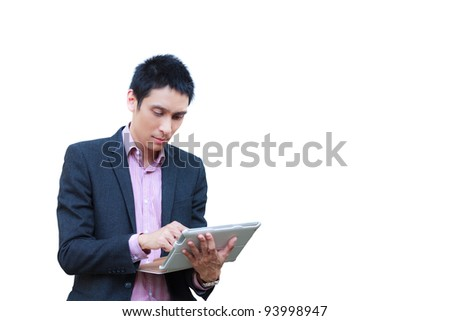 Young businessman standing with touch screen computer isolated on white - stock photo