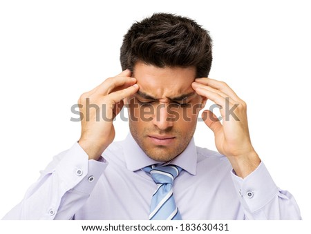 Young businessman suffering from headache touching temples over white background. Horizontal shot. - stock photo