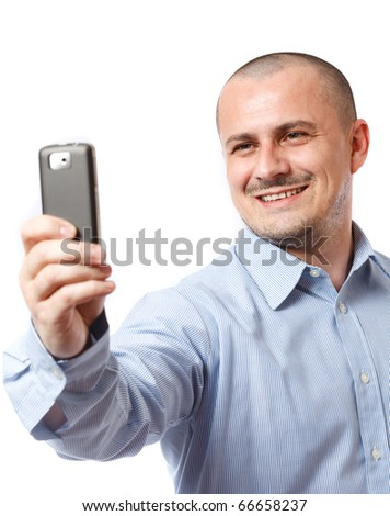 Young businessman taking photos with his cellphone - stock photo