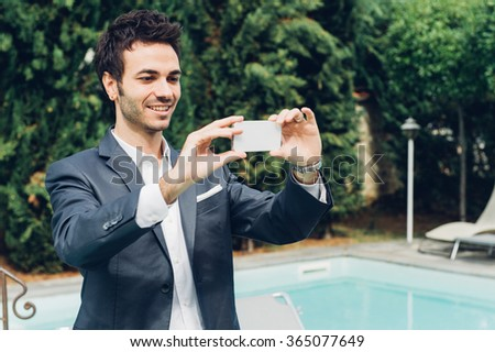 Young Businessman Taking Photos with Mobile - stock photo