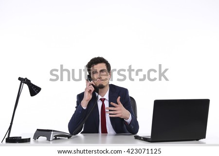 young businessman talking cellphone - stock photo