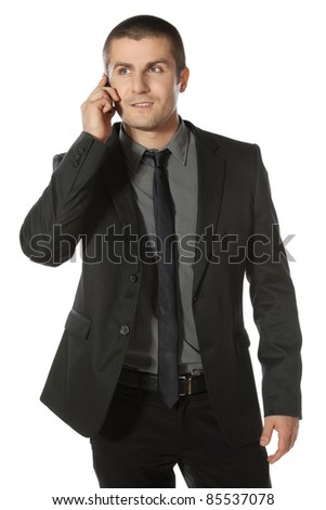 Young businessman talking on cell phone isolated on white background - stock photo