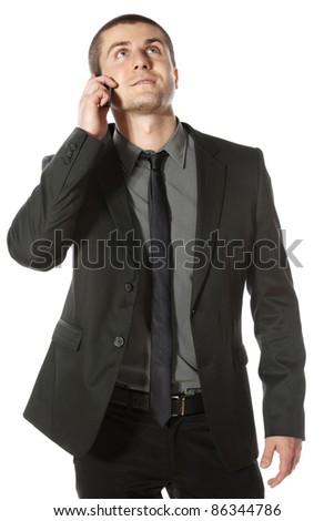 Young businessman talking on cell phone looking upwards isolated on white background - stock photo