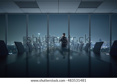 Young businessman talking on phone in conference room interior with table, chairs and night city view. 3D Rendering