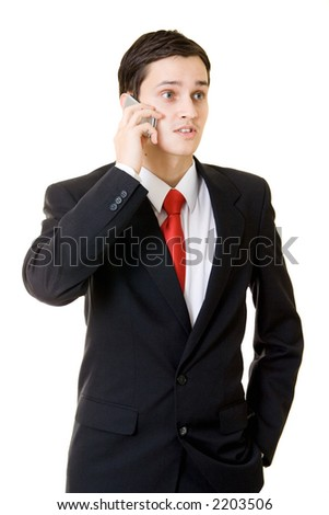 Young businessman talking on the cellular phone - stock photo