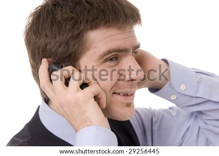 Young businessman talking on the phone - clouse up isolated