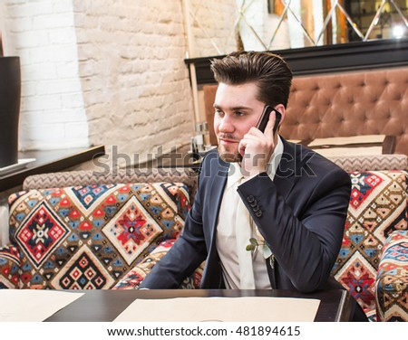 Young businessman talking on the phone indoors