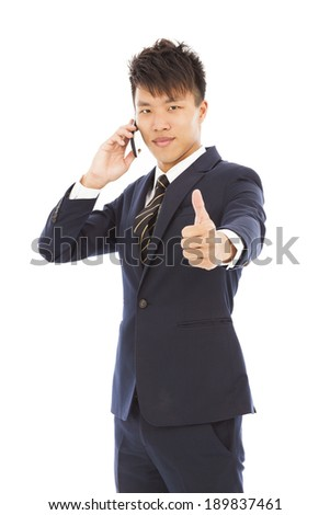 young businessman talking on the phone with thumb up - stock photo