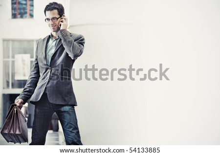 Young businessman talking over cellphone