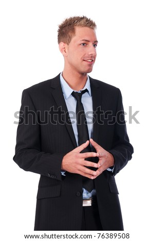 Young businessman talking to an audience - stock photo