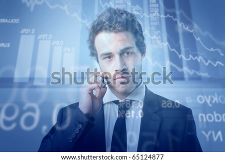 Young businessman talking to telephone with stock exchange graphics on the background