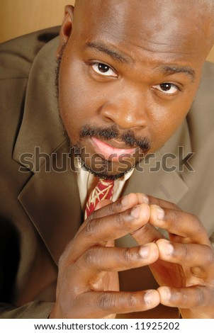Young businessman tapping fingers and thinking - stock photo