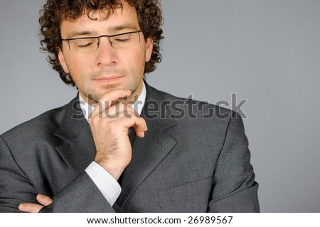Young businessman thinking - stock photo