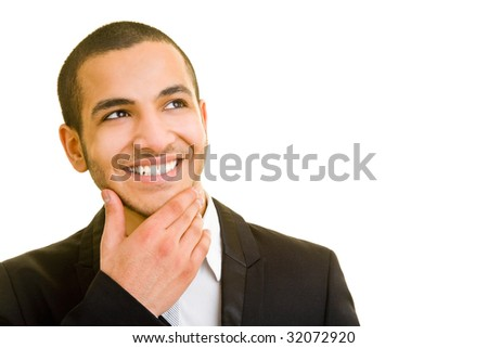 Young businessman thinking and looking up - stock photo