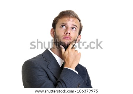 Young businessman thinking isolated in white
