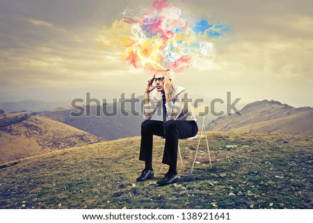 young businessman thinks intensely - stock photo