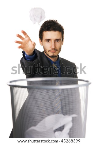 Young businessman throwing away crumpled paper, white background - stock photo