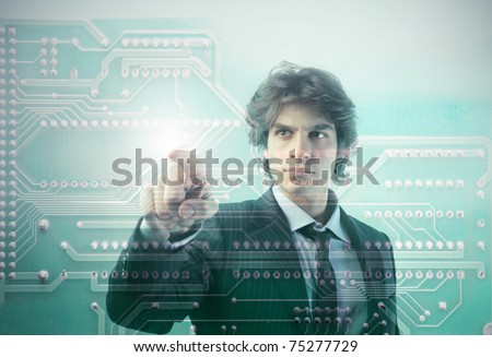 Young businessman touching a microchip - stock photo