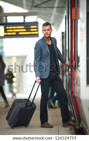 Young businessman traveling with bag at subway station - stock photo