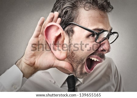 young businessman tries to listen - stock photo