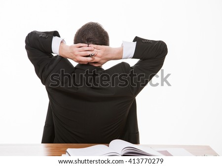 Young businessman turning back and dreaming, white background