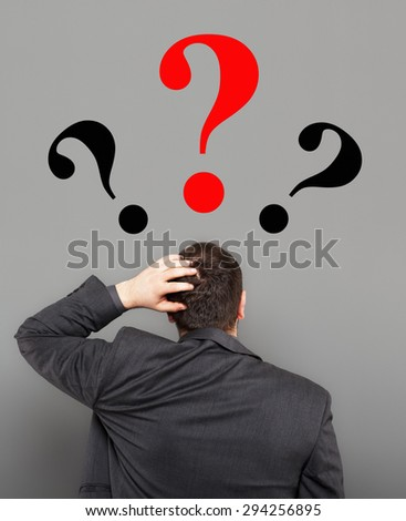 Young businessman undecided. - stock photo