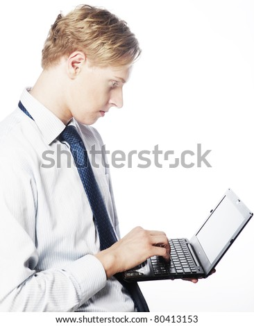 Young businessman use laptop on white background.