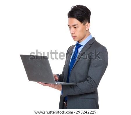 Young businessman use of the laptop computer