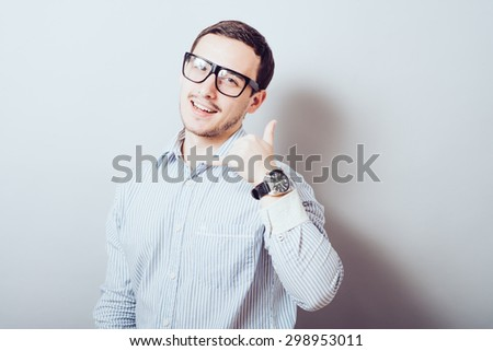 Young businessman using a call me gesture - stock photo