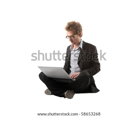 Young businessman using a laptop - stock photo
