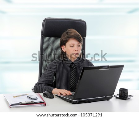 Young businessman using a laptop in the office. - stock photo