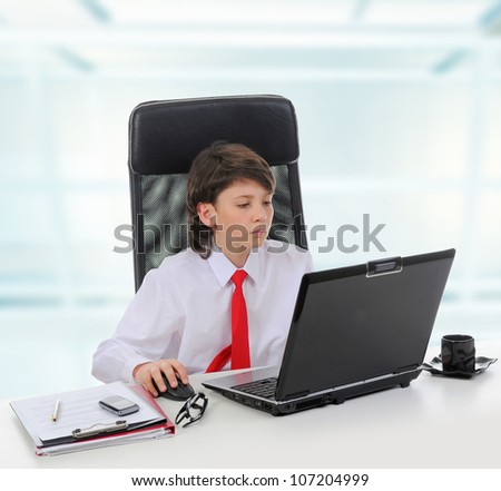 Young businessman using a laptop in the office. Isolated on white background - stock photo