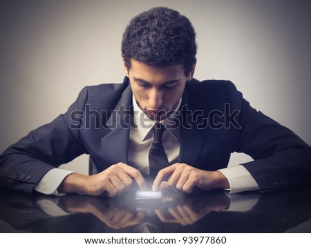 Young businessman using a mobile phone - stock photo