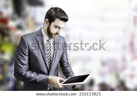 Young businessman using a tablet - stock photo