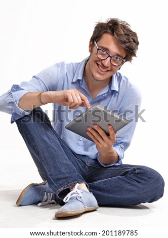 Young businessman using a tablet computer - isolated over a white background - stock photo